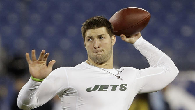 FILE - In this Dec. 17, 2012, file photo, then-New York Jets quarterback Tim Tebow warms up before an NFL football game in Nashville, Tenn. Tim Tebow is joining the New England Patriots, according to a report by ESPN on Monday, June 10, 2013. The high-profile quarterback who spent one season mostly on the sidelines with the New York Jets is expected to attend the start of the Patriots three-day minicamp on Tuesday. (AP Photo/Wade Payne, File)