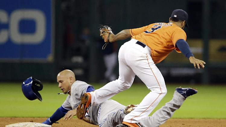 Toronto Blue Jays' Ryan Goins, left, is tagged out by Houston Astros shortstop Gregorio Petit (3) while trying to steal second base during the fifth inning of a baseball game Friday, Aug. 1, 2014, in Houston. (AP Photo/David J. Phillip)