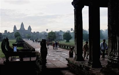 Foreign tourists tour a site inside Angkor archaeological park north of Siem