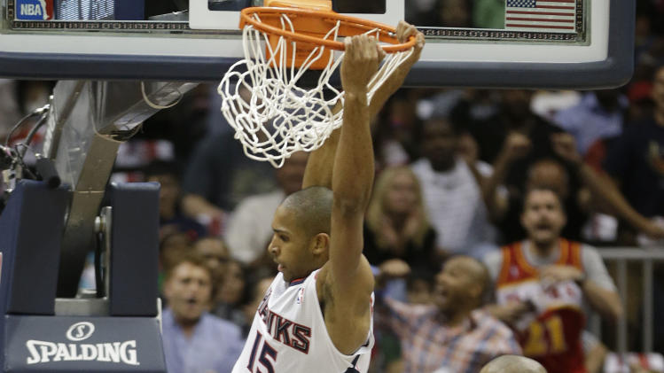 Atlanta Hawks center Al Horford (15) dunks the ball agains Indiana Pacers power forward David West (21) during the first half in Game 3 of their first-round NBA basketball playoff series, Saturday, April 27, 2013 in Atlanta. (AP Photo/John Bazemore)