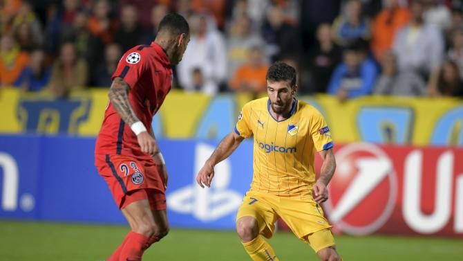 APOEL Nicosia's Efrem fights for the ball with Paris Saint-Germain's Van Der Wiel during their Champions League Group F soccer match at GSP  Stadium in Nicosia