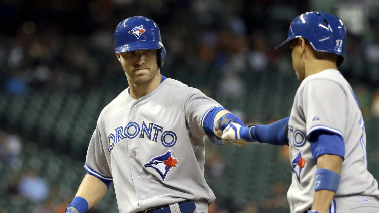 Toronto Blue Jays' Nolan Reimold, left, is congratulated by Ryan Goins, right, after hitting a home run against the Houston Astros during the fifth inning of a baseball game Thursday, July 31, 2014, in Houston. (AP Photo/David J. Phillip)