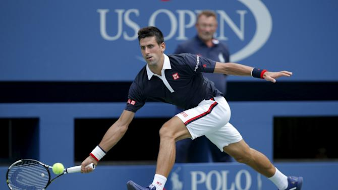 Djokovic of Serbia hits a return to Seppi of Italy during their match at the U.S. Open Championships tennis tournament in New York