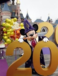 Mickey poses during the launch of Disneyland Paris&#39; 20th birthday celebrations in Chessy, outside Paris in March 2012. Last year, the park provided about 55,000 direct and indirect jobs