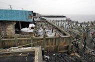 Heavily damaged by Superstrom Sandy, Jakeabob&#39;s Bay restaurant and piers are seen Tuesday, Feb. 5, 2013, in Union Beach, N.J. New Jersey Gov. Christie told a gathering in Union Beach Tuesday that the National Flood Insurance Program&#39;s handling of claims in New Jersey &quot;has stunk,&quot; complaining that the program has been far too slow to resolve claims from Superstorm Sandy, with 70 percent of cases unresolved three months after the disaster. (AP Photo/Mel Evans)