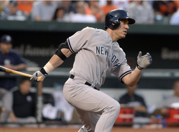 New York Yankees designated hitter Travis Hafner laces an RBI single to right field off of Baltimore Orioles starting pitcher Miguel Gonzalez in the third inning of their MLB American League baseball