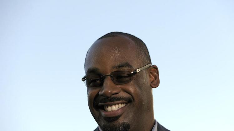 Former Philadelphia Eagles quarterback Donovan McNabb smiles during an interview before an NFL football game between the Philadelphia Eagles and the Kansas City Chiefs, Thursday, Sept. 19, 2013, in Philadelphia. McNabb is scheduled to have his jersey retired at halftime