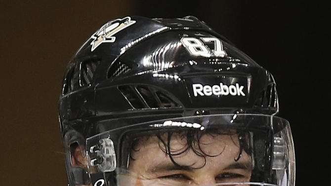 In this photo taken Jan. 14, 2013, Pittsburgh Penguins captain Sidney Crosby smiles during NHL hockey practice at the Consol Energy Center in Pittsburgh. The headaches are gone. Finally. So are the doubts, the ones Crosby couldn't outrun as he rehabilitated from concussion-like symptoms that robbed hockey's best player from two years in the middle of his prime. (AP Photo/Gene J. Puskar)