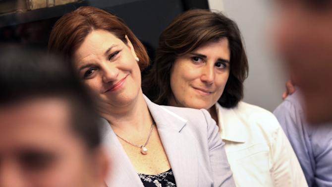 FILE - In this July 24, 2011 file photo, New York City Council Speaker Christine Quinn, left, and her partner, Kim Catullo, attend a wedding in the Manhattan City Clerk's office on the first day New York State's Marriage Equality Act goes into effect. Long seen as a leading contender, Quinn formally launched, on Sunday, March 10, 2013 what she hopes will be a history-making mayoral bid. Quinn would be a groundbreaking mayor across two personal dimensions: She would be the first female and first openly gay mayor to lead the nation's largest city. (AP Photo/Michael Appleton, Pool, File)