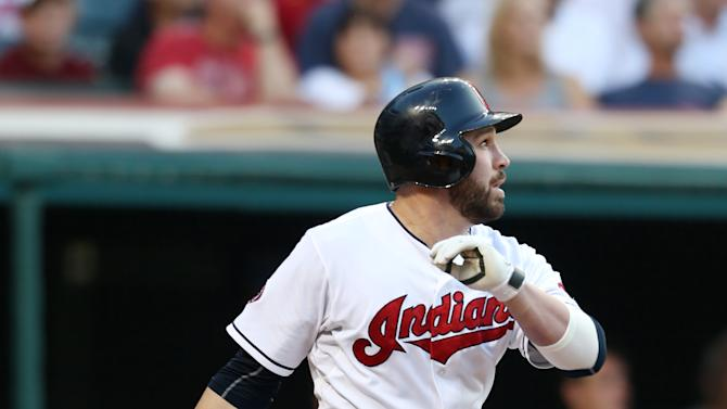 Cleveland Indians' Jason Kipnis hits a sacrifice fly to score Giovanny Urshela off Houston Astros starting pitcher Dallas Keuchel during the third inning of a baseball game, Monday, July 6, 2015, in Cleveland. (AP Photo/Ron Schwane)