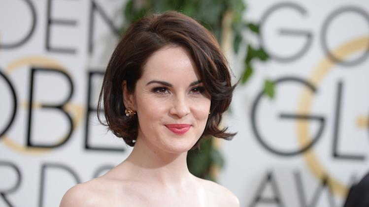 Michelle Dockery arrives at the 71st annual Golden Globe Awards at the Beverly Hilton Hotel on Sunday, Jan. 12, 2014, in Beverly Hills, Calif. (Photo by Jordan Strauss/Invision/AP)
