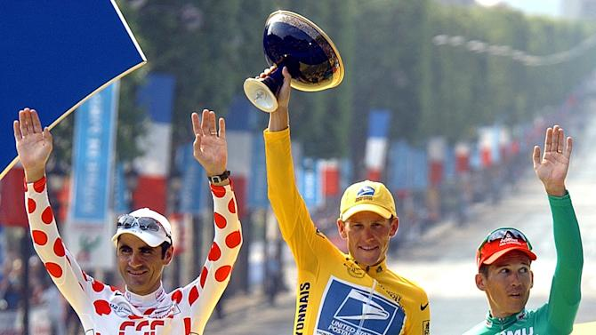 This July 28, 2002 file photo shows Tour de France winner Lance Armstrong, center, flanked by best sprinter Robbie McEwen, of Australia, right, and best climber Laurent Jalabert, of France, after the 20th and final stage of the Tour de France cycling in Paris. The superstar cyclist, whose stirring victories after his comeback from cancer helped him transcend sports, chose not to pursue arbitration in the drug case brought against him by the U.S. Anti-Doping Agency. That was his last option in his bitter fight with USADA and his decision set the stage for the titles to be stripped and his name to be all but wiped from the record books of the sport he once ruled.  (AP Photo/Peter Dejong, File)