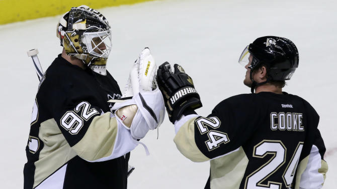 Pittsburgh Penguins goalie Tomas Vokoun (92) celebrates with Matt Cooke (24) after shutting out the New York Islanders 4-0 in Game 5 of an NHL hockey Stanley Cup first-round playoff series, Thursday, May 9, 2013, in Pittsburgh. The Penguins lead the series 3-2. (AP Photo/Gene J. Puskar)