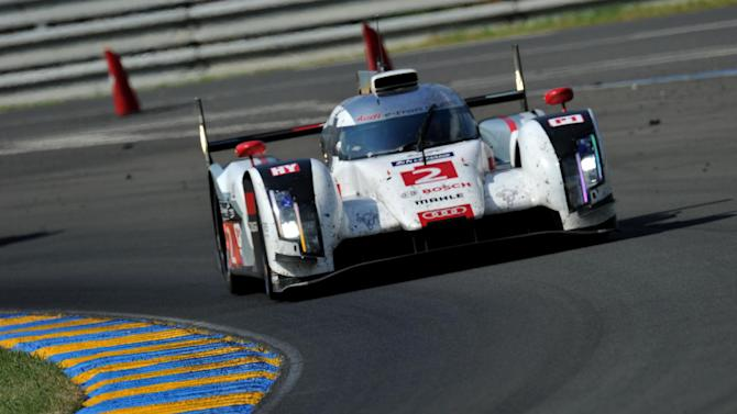 German driver Andre Lotterer in his Audi R18 E-Tron Quattro Hybrid N°2 competes during the 82nd Le Mans 24-hour endurance race, on June 15, 2014