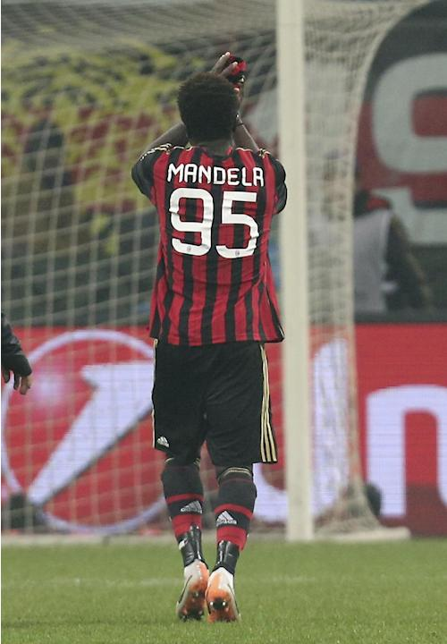 AC Milan midfielder Sulley Muntari, of Ghana, sports a jersey reading Mandela, as he leaves the pitch after a Champions League, Group H, soccer match between AC Milan and Ajax at the San Siro stadium