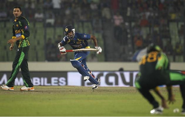 Sri Lankan cricket player Lahiru Thirimanne, center, runs between the wickets during the Asia Cup final cricket match between Sri Lanka and Pakistan in Dhaka, Bangladesh, Saturday, March 8, 2014. (AP