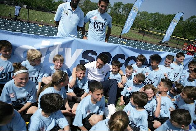 IMAGE DISTRIBUTED FOR MANCHESTER CITY FC - As part of Manchester City's 2013 US Tour the team has partnered with the BINI Fund to donate soccer equipment to help those impacted by hurricane Sandy to g