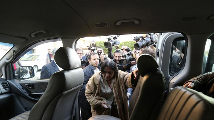 Mother of British surgeon Abbas Khan gets into a vehicle at the Hotel-Dieu de France Hospital in Beirut