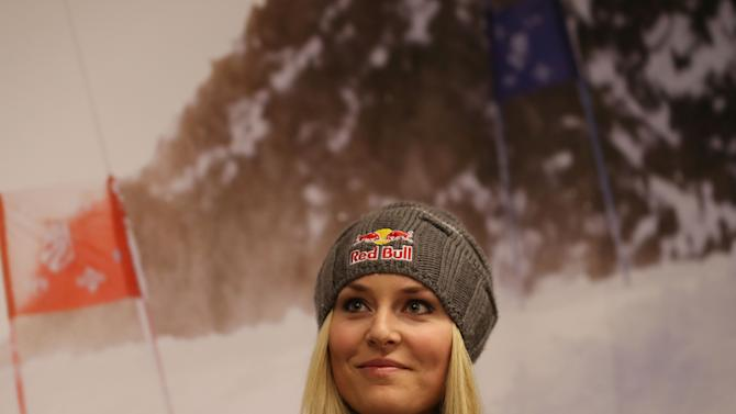 U.S. ski racer Lindsey Vonn watches during a press conference in view of the World Cup Alpine Skiing, in Schladming, Austria, Sunday, Feb. 3, 2013. With media attention on her personal life intensifying and some 400,000 fans expected, Lindsey Vonn will be surrounded by bodyguards at the Alpine skiing world championships starting Tuesday. (AP Photo/Luca Bruno)