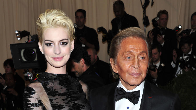 "Anne Hathaway, left, and Valentino Garavani attends The Metropolitan Museum of Art's Costume Institute benefit celebrating ""PUNK: Chaos to Couture"" on Monday May 6, 2013 in New York. (Photo by Charles Sykes/Invision/AP)"