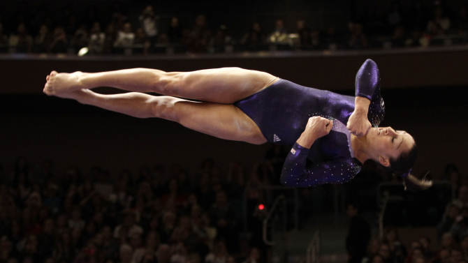Women's All-Around winner Jordyn Wieber of the United States leaps off the balance beam during the American Cup gymnastics meet at Madison Square Garden in New York, Saturday, March 3, 2012.  (AP Photo/Kathy Willens)