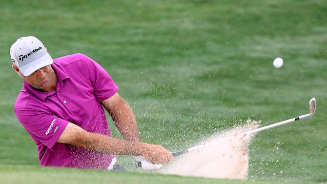 Stewart Cink takes a bunker shot on hole eighteen during the third round of the Shell Houston Open golf tournament on Saturday, March, 30, 2013, in Humble, Texas. (AP Photo/ Patric Schneider)