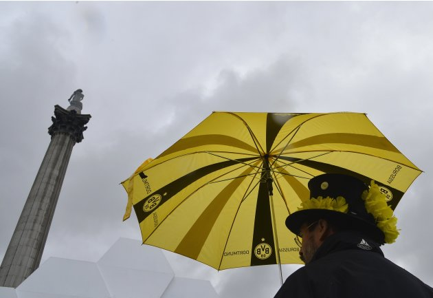 A Borussia Dortmund supporter raises an umbrella in front of the Nelson's Column statue in Trafalgar Square in central London