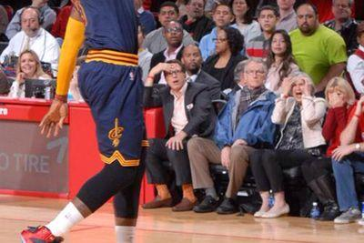 Woman sitting courtside has her mind blown by a LeBron James dunk