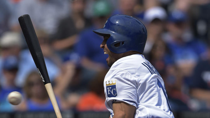 Kansas City Royals second baseman Omar Infante (14) is hit by a pitch during the second inning of their baseball game against the Detroit Tigers, Saturday, Sept. 20, 2014, in Kansas City, Mo. (AP Photo/Reed Hoffmann)