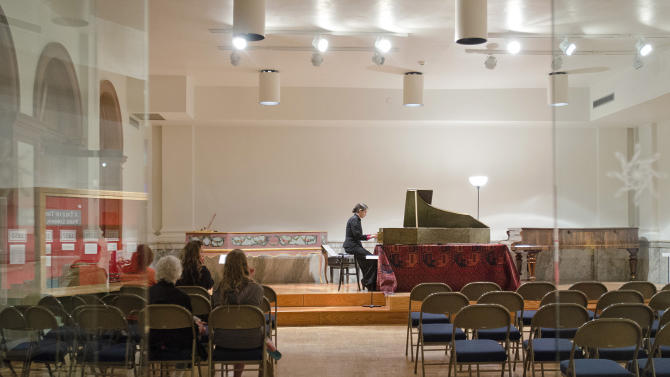 This May, 8, 2015 photo shows keyboardist Catalina Vicens playing a harpsichord at the National Music Museum in Vermillion, S.D. The instrument, used in the mid-1500s to entertain the elites in Italy, has been restored by a the museum in an effort to soon let 21st century ears listen to what's now the oldest-known playable harpsichord. The museum worked with Chilean-born musician Vicens, who specializes historical keyboards and percussion instruments, to produce the harpsichord's first full-length recording. (Justin Wan/The Sioux City Journal via AP)