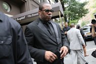 "Busta Rhymes leaves the Frank E. Campbell Funeral Chapel following the service for hip-hop mogul Chris Lighty, Wednesday Sept. 5, 2012 in New York. Mourners in the packed chapel Wednesday included Sean ""Diddy"" Combs, Missy Elliott, Q-Tip, LL Cool J, Russell Simmons, 50 Cent and Grandmaster Flash. Lighty, the 44-year-old hip-hop mogul was found dead in his Bronx apartment last week with a gunshot wound to the head. (AP Photo/Tina Fineberg)"
