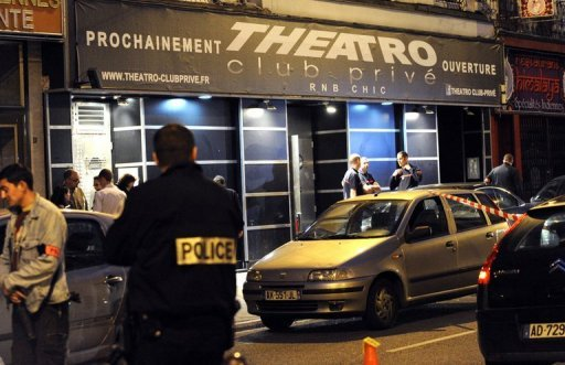 Police investigate on the scene where two people were shot dead when a gunman opened fire on a discotheque in the northern French town of Lille. A guman shot dead two people at a nightclub in northern France in what appeared to be a revenge attack after he was kicked out of the disco.
