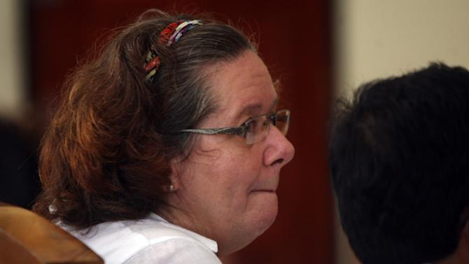 FILE - In this Jan. 7, 2013 file photo, Lindsay June Sandiford of Britain sits at a courthouse during her trial in Denpasar, Bali island, Indonesia. An Indonesian court sentenced Sandiford to death Tuesday, Jan. 22, for smuggling cocaine worth $2.5 million into the resort island of Bali. (AP Photo/Firdia Lisnawati, File)