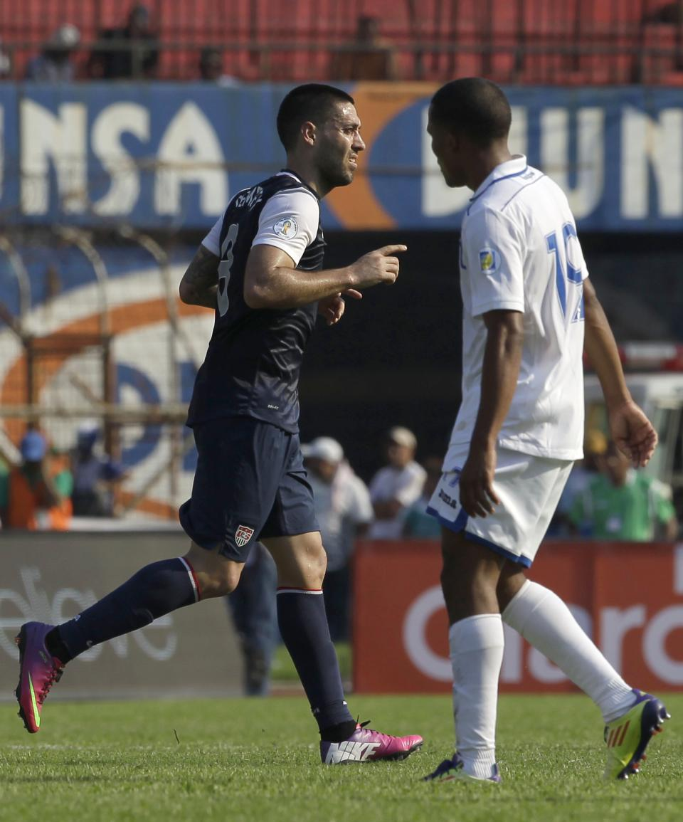 U.S. Clint Dempsey, left, celebrates after scoring against Honduras during a 2014 World Cup qualifying soccer game in San Pedro Sula, Honduras, Wednesday Feb. 6, 2013. (AP Photo/Moises Castillo)