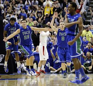 Florida Gulf Coast's Eric McKnight, from left, Chase Fieler, Brett Comer and Bernard Thompson celebrate after a dunk by McKnight late the second half of a third-round game against San Diego State in the NCAA college basketball tournament, Sunday, March 24, 2013, in Philadelphia. Florida Gulf Coast won 81-71. (AP Photo/Matt Slocum)