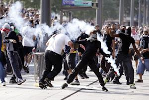 Rioters clash with French riot police officers, on …
