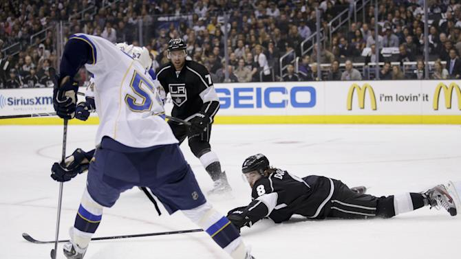 Los Angeles Kings' Drew Doughty reaches for the puck as he defends St. Louis Blues' David Perron, left, during the first period in Game 3 of a first-round NHL hockey Stanley Cup playoff series n Los Angeles, Saturday, May 4, 2013. (AP Photo/Jae C. Hong)
