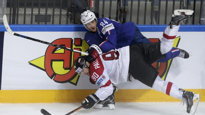 Austria's Pallestrang collides with France's Hecquefeuille during their Ice Hockey World Championship game at the O2 arena in Prague