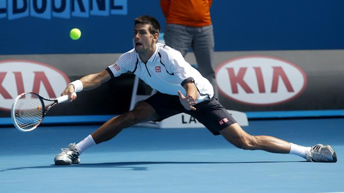 Serbia's Novak Djokovic reaches to play a forehand return to Radek Stepanek of the Czech Republic during their third round match at the Australian Open tennis championship in Melbourne, Australia, Friday, Jan. 18, 2013. (AP Photo/Dita Alangkara)