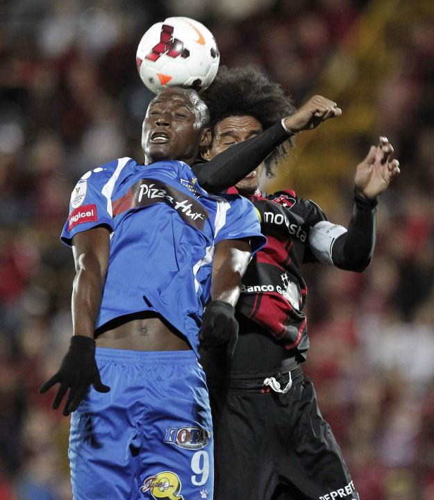 Adiel Arroyo of Panama's Arabe Unido, fights for the ball with Porfirio Lopez of Costa Rica's Alajuelense during their CONCACAF Champions League soccer match at Alejandro Morera Soto Stadium i