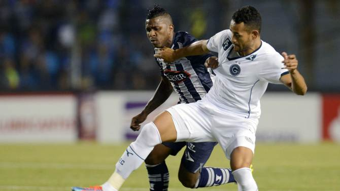 Bolanos of Ecuador's Emelec fights for the ball with de Souza of Brazil's Goias during their Copa Sudamericana match in Guayaquil