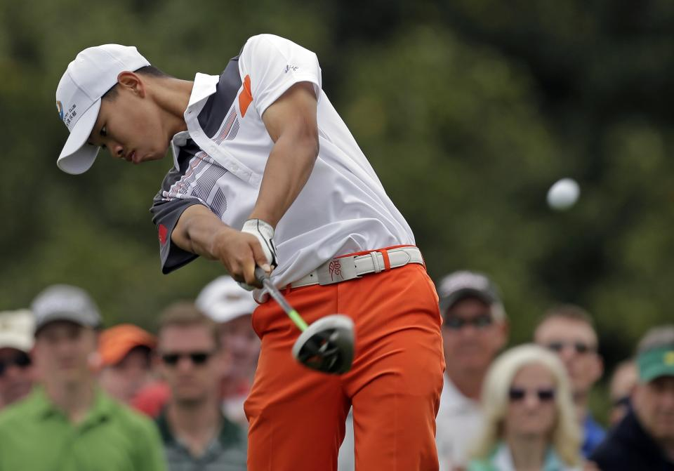 Amateur Guan Tianlang, of China, tees off on the 10th hole during the fourth round of the Masters golf tournament Sunday, April 14, 2013, in Augusta, Ga. (AP Photo/Charlie Riedel)