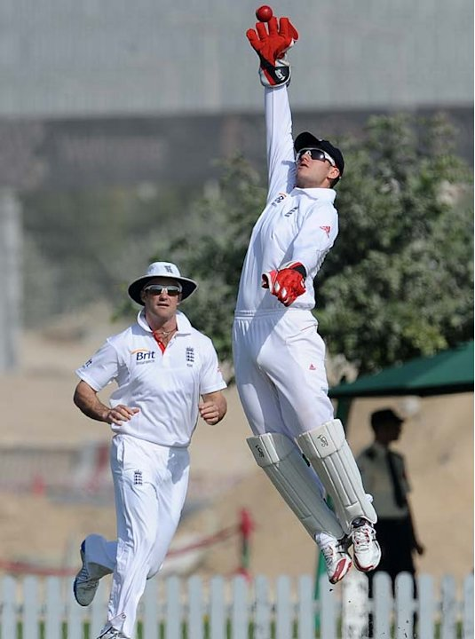 England XI wicketkeeper Steven Davies (R) attempts to field a ball as captain Andrew Strauss (L) look on during the opening day of a three-day practice match between the England XI and ICC Combined As