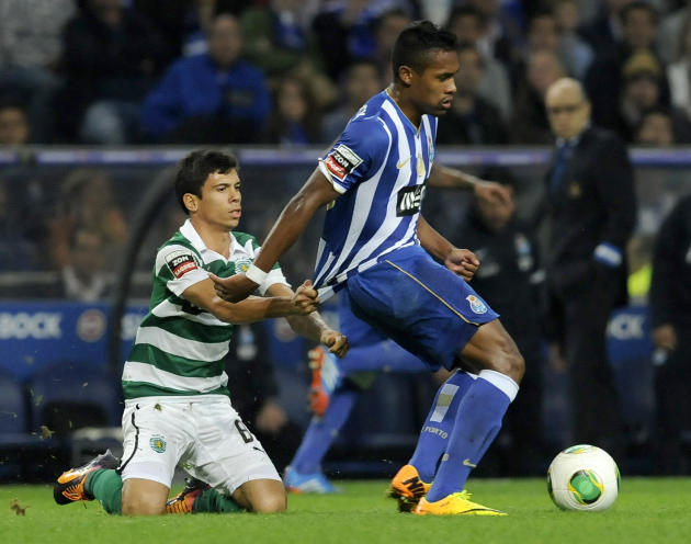 Sporting's Andre Martins, left, grabs FC Porto's Danilo Silva, from Brazil, during a Portuguese League soccer match at the Dragao stadium in Porto, Portugal, Sunday, Oct. 27, 2013. Danilo scored once