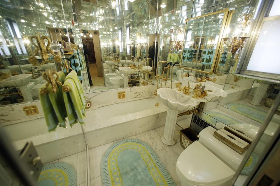 The mirrored bathroom is on display at the Louis Armstrong House Museum Wednesday, Oct. 9, 2013, in the Queens borough of New York. (AP Photo/Frank Franklin II)