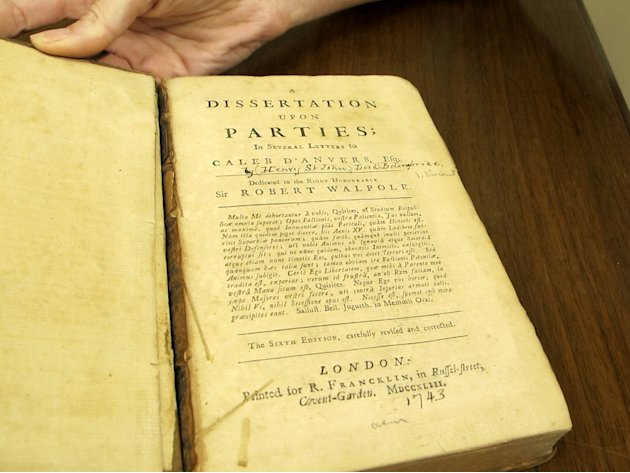 A rare 1743 book is shown at the Charleston Library Society in Charleston, S.C., on Monday, May 7, 2012. The volume, which was found in the vault of the Charleston Library Society, really belongs to t