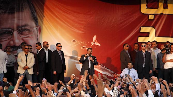 Egyptian President Mohammed Morsi speaks to supporters outside the Presidential palace in Cairo, Egypt, Friday, Nov. 23, 2012. Opponents and supporters of Mohammed Morsi clashed across Egypt on Friday, the day after the president granted himself sweeping new powers that critics fear can allow him to be a virtual dictator. (AP Photo/Aly Hazaza, El Shorouk)