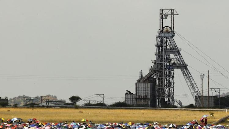 Striking miners gather for a meeting outside the Impala Platinum mine in Rustenburg