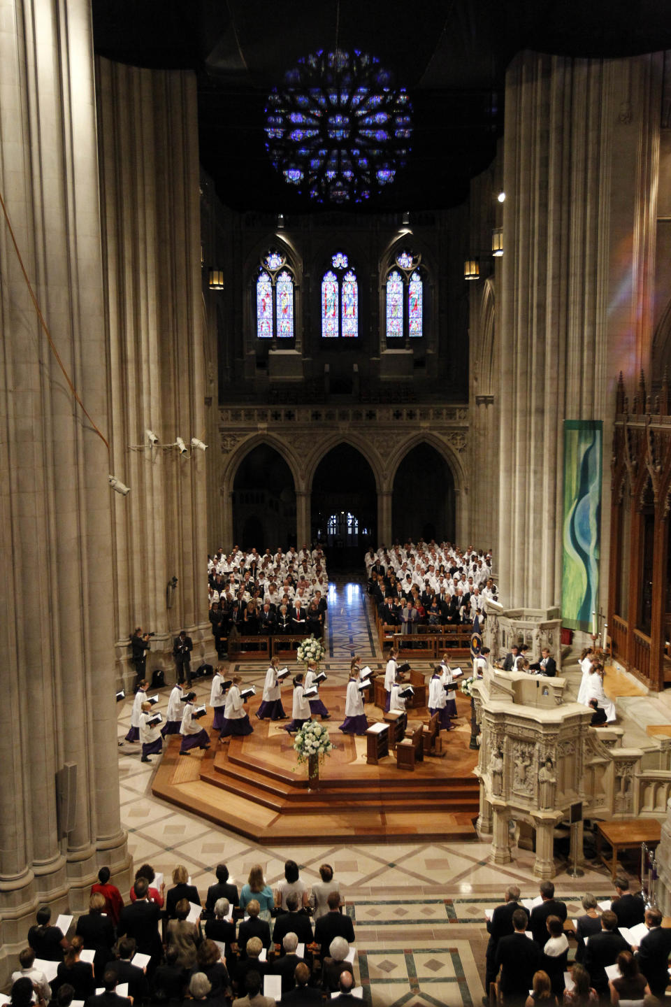 Members of the choir enter during the processional at the Washington National Cathedral in Washington, Thursday, Sept. 13, 2012, for  the national memorial service for the first man to walk on the moon, Neil Armstrong. (AP Photo/Ann Heisenfelt)