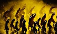 Actors perform during the opening ceremony of the London 2012 Olympic Games at the Olympic Stadium in London